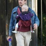 Ethan Hawke wears an Ergobaby carrier